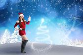 Sexy santa girl pointing — Stock Photo