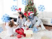 Family opening Christmas presents — Stock Photo