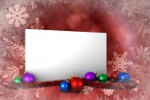 Composite image of poster with baubles — Stockfoto
