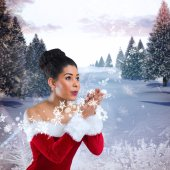 Santa girl blowing over her hands — Stock Photo