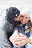Attractive couple on the beach in warm clothing — Stockfoto