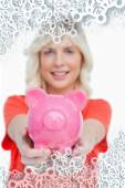 Pink piggy bank held by a smiling attractive woman — Stock Photo