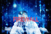 Word firewall and focused businessman — Stock Photo