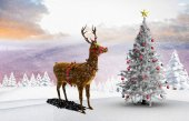 Composite image of christmas tree and reindeer — Stock Photo