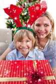 Mother and her son unpacking gift — Stock Photo