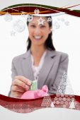 Money being put into piggy bank by businesswoman — Stock Photo