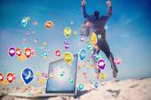 Businessman jumping on beach — Stock Photo