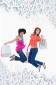 Young teenagers energetically jumping after going shopping — Stock Photo