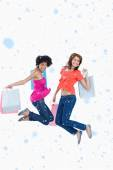 Teenagers energetically jumping after going shopping — Stockfoto