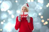 Happy festive blonde with gift — Stockfoto