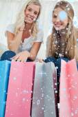 Bags with girls above them smiling — Stock Photo