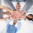 Four workers stacking hands together — Stock Photo #53912801