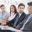 Business team looking at laptop — Stock Photo #53914129