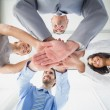 Four workers stacking hands together — Stock Photo #53914591