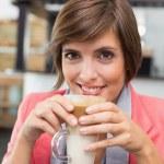 Pretty brunette enjoying her latte — Stock Photo #53914635
