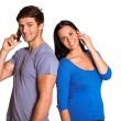 Young couple talking on their phones — Stock Photo #53915259