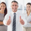 Smiling businessman giving thumbs up — Stock Photo #53915267