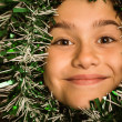 Cute little girl with tinsel around her head — Stock Photo #53915349