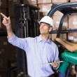 Warehouse manager talking with forklift driver — Stock Photo #53915703