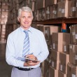 Warehouse manager writing on clipboard — Stock Photo #53916051