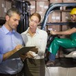 Warehouse team working together with clipboard — Stock Photo #53916285