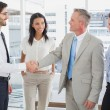 Business man shaking colleagues hand — Stock Photo #53916635
