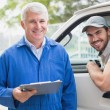 Delivery driver with customer — Stock Photo #53916869