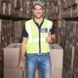 Warehouse worker smiling at camera — Stock Photo #53917109