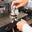 Barista making a cup of coffee — Stock Photo #53917359