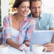 Happy couple on a date using tablet pc — Stock Photo #53917703