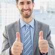 Businessman giving a thumbs up — Stock Photo #53918935