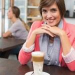 Pretty brunette enjoying her latte — Stock Photo #53919127
