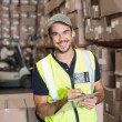 Warehouse worker with clipboard — Stock Photo #53919705