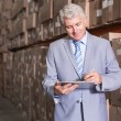 Warehouse manager writing on clipboard — Stock Photo #53919915