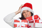 Shocked woman with christmas presents — Stock Photo