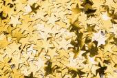 Many gold star decorations background — Stock Photo