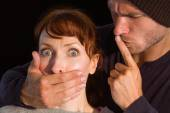 Man grabbing woman around mouth — Stock Photo