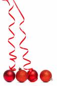 Four red christmas ball decorations — Stock Photo