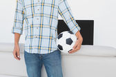 Mid section of a football fan — Stock Photo
