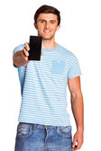 Young man showing phone to camera — Stok fotoğraf