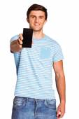 Young man showing phone to camera — Stock fotografie