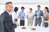 Business team enjoying some drinks — Stock Photo