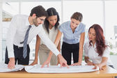 Business team reading work plans — Foto Stock