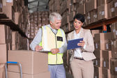 Warehouse manager talking to foreman — Stock Photo