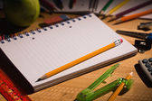 Students table with school supplies — Foto de Stock