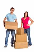 Young couple with moving boxes — Stock Photo