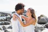 Gorgeous couple embracing by the coast — Stock Photo