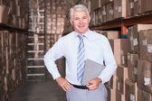 Smiling warehouse manager looking at camera — Stock Photo