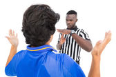 Serious referee showing time out sign to player — Stock Photo