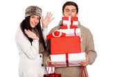Young couple with many christmas presents — Stock Photo